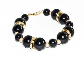 Armband svarta guldfärgade