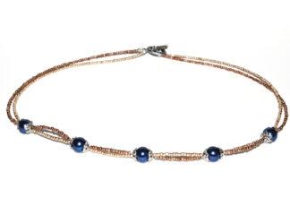 Halsband blå guld kopparfärgade