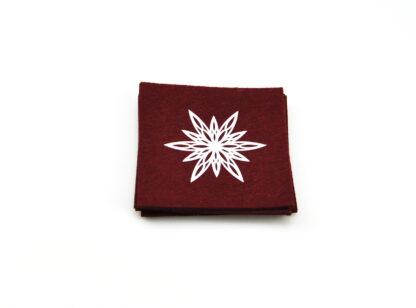 Rött underlägg vitt stjärntryck